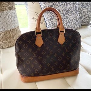 Louis Vuitton Alma handbag.
